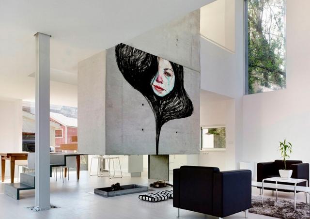 diseno-minimalista-interior-chimenea-sillones-negros-1